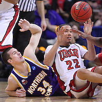 Northern Iowa forward Adam Koch (34) and UNLV guard/forward Chace Stanback (22) battle for a lose ball during a first round game in the men's NCAA basketball tournament at the Ford Center in Oklahoma City, Okla., Thursday, March 18, 2010.