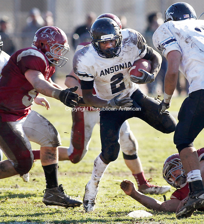Naugatuck, CT- 24 November 2011-112411CM08-  Ansonia's Arkeel Newsome (2) breaks through Naugatuck's defense, including Matt Carda (left) during their Thanksgiving matchup at Naugatuck High School Thursday morning.  Newsome scored his third touchdown on the play and went on to score two more on the day as Ansonia defeated Naugy 49-14.  Christopher Massa Republican-American