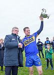 Newmarket  captain Colin Ryan accepts the cup from Clare GAA chairman Joe Cooney following their win over Sixmilebridge in the Clare Champion Cup final at Clonlara. Photograph by John Kelly.
