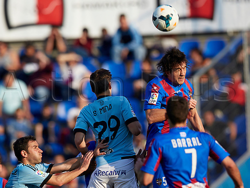 15.03.2014 Valencia, Spain.Defender Hector Rodas of Levante U.D. (R) heads the ball challenged by Forward Santi Mina  (3rd R)during the La Liga game between Levante UD and Real Club  Celta de Vigo at Ciutat de Valencia stadium, Valencia