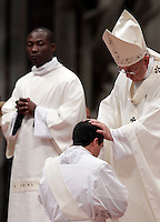 Papa Francesco pone le sue mani sul capo di un ordinando durante una messa per l'ordinazione di 19 nuovi sacerdoti nella Basilica di San Pietro, Citta' del Vaticano, 26 aprile 2015.<br /> Pope Francis puts his hands on the head of an ordinand during a mass for the ordination of 19 new priests in St. Peter's Basilica at the Vatican, 26 April 2015.<br /> UPDATE IMAGES PRESS/Riccardo De Luca<br /> <br /> STRICTLY ONLY FOR EDITORIAL USE