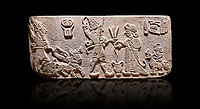 """Aslantepe Hittite Orthostat. Limestone, Aslantepe, Malatya, 1200-700 B.C. Anatolian Civilizations Museum, Ankara, Turkey.<br /> <br /> Scene of offering drink and sacrifice. The god, with a symbol of divinity above, is in the chariot while holding a boomerang in his hand and a sword at his waist. The same god holds a lightning bundle in the middle. On the right, the king offers a drink to god. The inscription above reads """"Great, powerful King Sulumeli"""". A servant stands behind holding a bull for sacrifice to the gods. Anatolian Civilizations Museum, Ankara, Turkey<br /> <br /> Against a black background."""