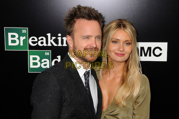 Aaron Paul, Lauren Parsekian<br /> &quot;Breaking Bad&quot; Final Episodes Los Angeles Premiere Screening held at Sony Pictures Studios, Culver City, California, USA, 24th July 2013.<br /> portrait headshot  grey gray black suit tie green khaki dress<br /> CAP/ADM/BP<br /> &copy;Byron Purvis/AdMedia/Capital Pictures
