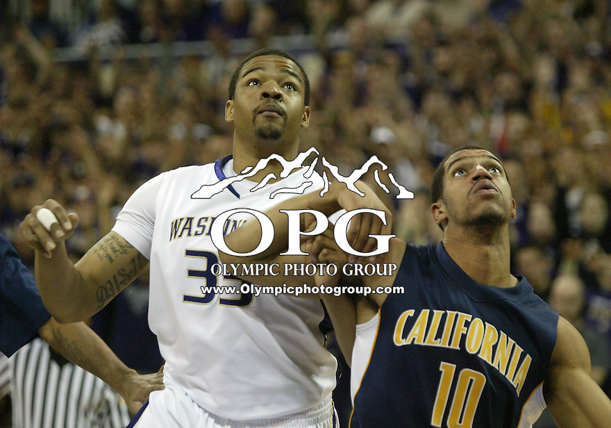 16 January 2010:  Washington Huskies forward #33 Tyreese Breshers and California's #10 Jamal Boykin set up under the basket for a rebound. Washington won 84-69 over California at the Bank of America Arena in Seattle, WA.