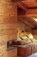 in a corner of the living room under the eaves a cosy daybed can be easily adapted as a guest bed