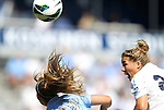 09 September 2012: UNC's Amber Brooks (22) heads the ball over San Diego's Kelley McCloskey (21). The University of North Carolina Tar Heels defeated the University of San Diego Toreros 5-0 at Koskinen Stadium in Durham, North Carolina in a 2012 NCAA Division I Women's Soccer game.