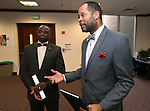 Nevada Senate Democrats Kelvin Atkinson, left, and Aaron Ford talk Friday night about a measure that would appropriate $1.3 million to equip Nevada Highway Patrol troopers with body cameras by 2017. The bill was approved by the Senate Finance Committee Friday at the Legislative Building in Carson City, Nev., on Friday, May 29, 2015. <br /> Photo by Cathleen Allison