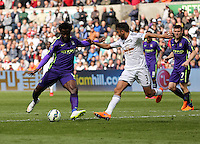 SWANSEA, WALES - MAY 17: Wilfried Bony of Manchester City (L) against Neil Taylor of Swansea scores the winning goal during the Premier League match between Swansea City and Manchester City at The Liberty Stadium on May 17, 2015 in Swansea, Wales. (photo by Athena Pictures/Getty Images)