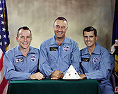 """Houston, TX - April 1, 1966 -- Portrait of the Apollo 1 prime crew for first manned Apollo space flight. From left to right are: Edward H. White II, Virgil I. """"Gus"""" Grissom, and Roger B. Chaffee. On January 27, 1967 at 5:31 p.m. CST (6:31 local time) during a routine simulated launch test onboard the Apollo Saturn V Moon rocket, an electrical short circuit inside the Apollo Command Module ignited the pure oxygen environment and within a matter of seconds all three Apollo 1 crewmembers perished. .Credit: NASA via CNP"""