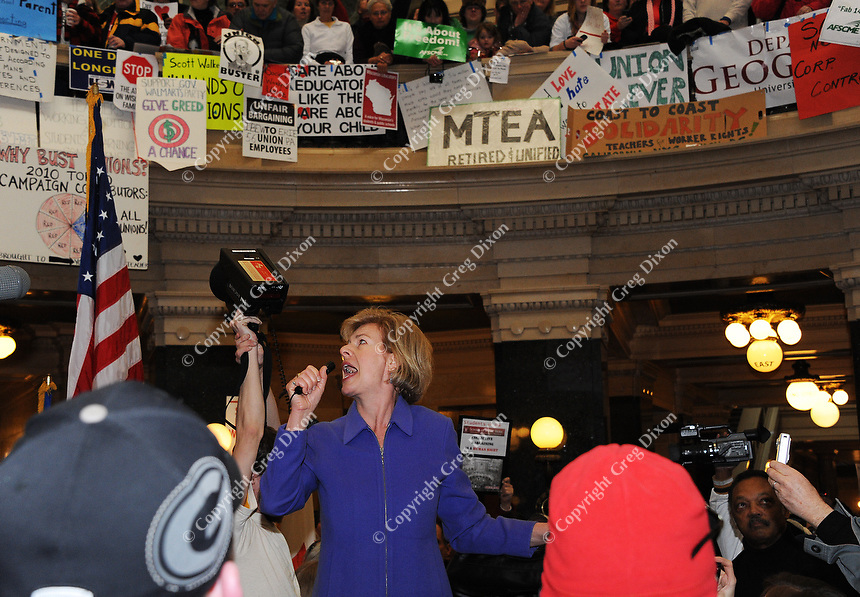 US Representative Tammy Baldwin addresses a crowd in the Wisconsin State Capitol in Madison during a protest of Wisconsin Governor Scott Walker's proposed changes to state union laws