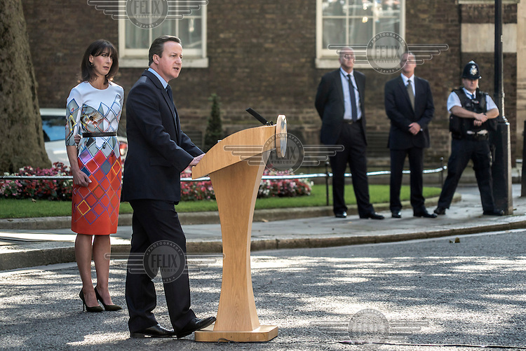 Prime Minister David Cameron, accompanied by his wife Samantha, makes a statement to the media, outside number 10 Downing Street, after losing the EU referendum vote.
