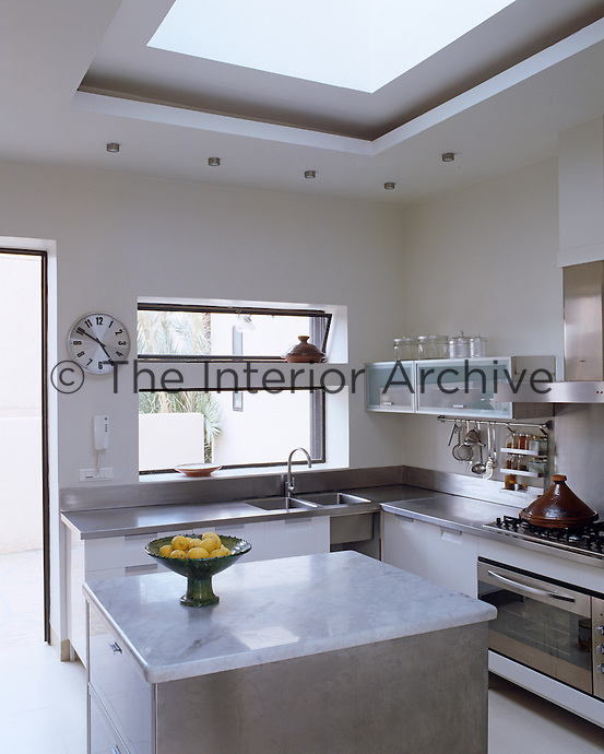 Marble and stainless steel combine to create a cool and modern kitchen