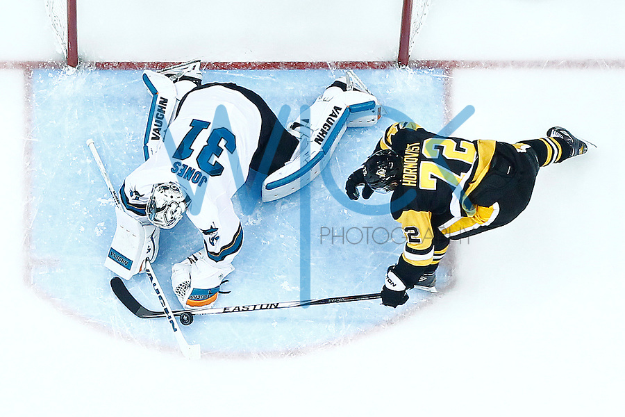 Patric Hornqvist #72 of the Pittsburgh Penguins tries to pry the loose puck in front of Martin Jones #31 of the San Jose Sharks in the second period during game five of the Stanley Cup Final at Consol Energy Center in Pittsburgh, Pennsylvania on June 9, 2016. (Photo by Jared Wickerham / DKPS)