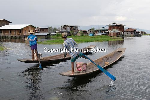 Traditional rowing action. Inle lake. Myanmar (Burma.) 2006