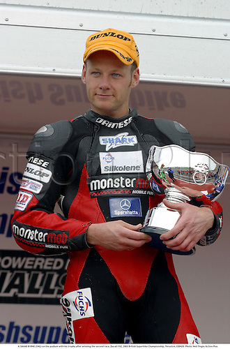 4. SHANE BYRNE (ENG) on the podium with his trophy after winning the second race, Ducati F02, 2003 British Superbike Championship, Thruxton, 030420. Photo: Neil Tingle/Action Plus...motor motorsport motorsports bike bikes superbikes .winner winners