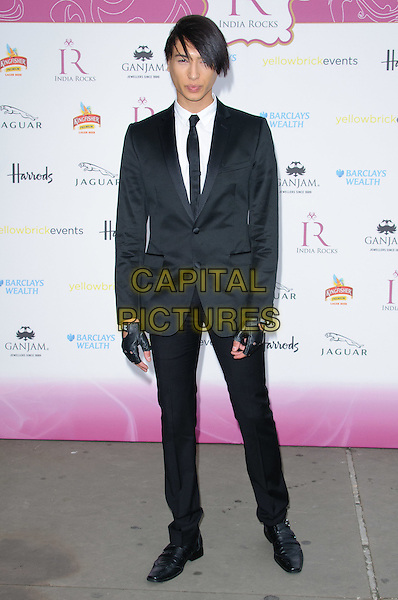 Natt Weller.India Rocks Party at The Natural History Museum - Arrivals. London, England..June 27th, 2011.full length black suit tie white shirt fingerless gloves.CAP/CJ.©Chris Joseph/Capital Pictures.