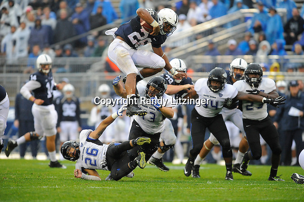 12 September 2015:  Penn State true freshman RB Saquon Barkley (26) hurdles Buffalo's Ryan Williamson (26) and Nick Gilbo (43) during a long gain. Barkley ran for 115 yards and a touchdown. The Penn State Nittany Lions defeated the Buffalo Bulls 27-14 at Beaver Stadium in State College, PA.
