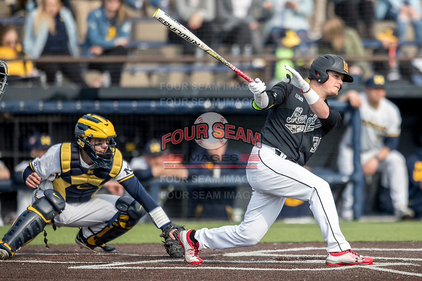Maryland Terrapins second baseman Nick Dunn (39) follows through on his swing against the Michigan Wolverines on April 13, 2018 in a Big Ten NCAA baseball game at Ray Fisher Stadium in Ann Arbor, Michigan. Michigan defeated Maryland 10-4. (Andrew Woolley/Four Seam Images)