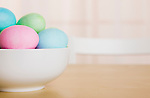 Easter eggs in bowl on table