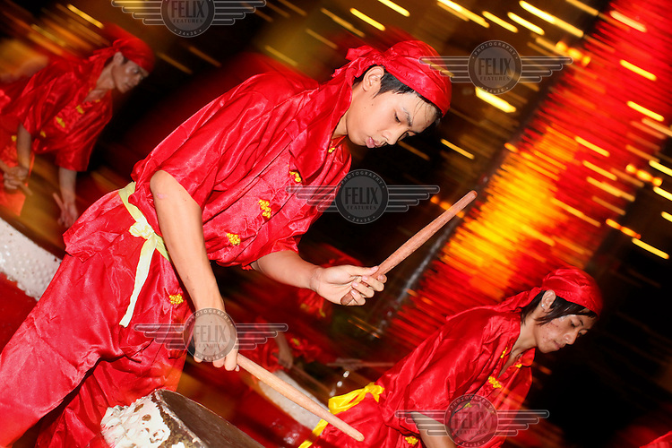 Men play drum and percussion music for the Chinese New Year Lion Dance.