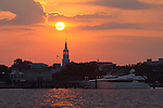 Sunset over St Michaels Church and Mega Yacht Muse on the Charleston Harbor South Carolina