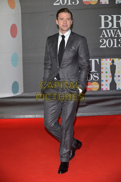 Justin Timberlake.The Brit Awards 2013 arrivals at the O2, Greenwich, London, England 20th February 2013.The Brits full length grey gray suit hands in pockets black tie white shirt .CAP/PL.©Phil Loftus/Capital Pictures.