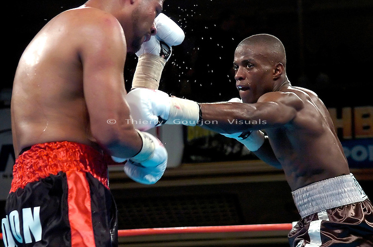 Peter Quillin (brown)  on the attack against  Tomas Padron during their  Middleweight 4 rounds fight at the Hammerstein ballroom in New York, NY on 04.20.06. Peter Quillin won by UD..