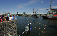 Partipants  takes part in the Amsterdam City Swim in the Amsterdam canals to raise money for the treatment of ALS, or Lou Gehrig's disease, in Amsterdam, Netherlands, Sunday September 8, 2013 - ( Photo by Paulo Amorim)