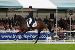 Sam Griffiths [AUS] riding Happy Times during the Dressage phase of the 2014 Land Rover Burghley Horse Trials held at Burghley House, Stamford, Lincolnshire