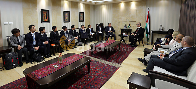 Palestinian Prime Minister Rami Hamdallah meets with a delegation of Japanese businessmen, at his office in the West Bank city of Ramallah on July 13, 2017. Photo by Prime Minister Office