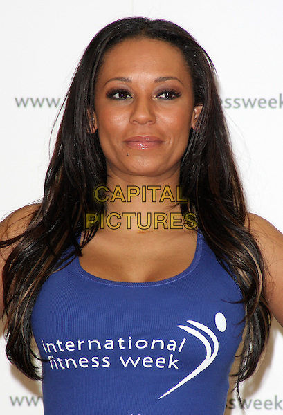 MEL B - MELANIE BROWN.Launches International Fitness Week at Fitness First, Tottenham Court Road, London -  .January 28th, 2010.half length scary spice blue purple tank top.CAP/ROS.©Steve Ross/Capital Pictures.