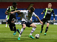 Bolton Wanderers' Chris Long holds off the challenge from Bury's Leon Barnett<br /> <br /> Photographer Alex Dodd/CameraSport<br /> <br /> The EFL Sky Bet League One - Bolton Wanderers v Bury - Tuesday 18th April 2017 - Macron Stadium - Bolton<br /> <br /> World Copyright &copy; 2017 CameraSport. All rights reserved. 43 Linden Ave. Countesthorpe. Leicester. England. LE8 5PG - Tel: +44 (0) 116 277 4147 - admin@camerasport.com - www.camerasport.com