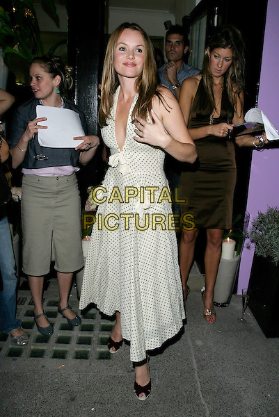 AMANDA HOLDEN.Kyri - flagship store launch party at Kyri (Flaghip Store), Elizabeth Street, London, UK..September 6th, 2006.Ref: AH.full length white green polka dot dress plunging neckline.www.capitalpictures.com.sales@capitalpictures.com.©Adam Houghton/Capital Pictures.