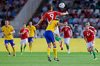 Hungary's Imre Szabics (L) and Sweden's Andreas Granqvist (R) go for a header during the UEFA EURO 2012 Group E qualifier Hungary playing against Sweden in Budapest, Hungary on September 02, 2011. ATTILA VOLGYI