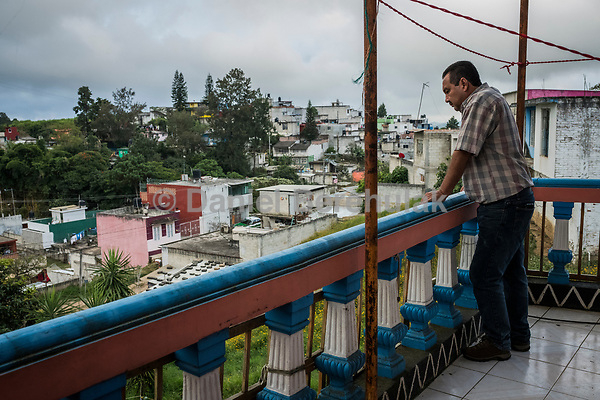 Carlos Saldana, looks out as he stands on the balcony as he attends a birthday party for their grandson, Hector Yael, 10, at a family gathering at Vicky's daughter, Cinthia Hernández Delgadilo's house in Xalapa, Mexico on November 4, 2017. <br /> Photo Daniel Berehulak for The New York Times
