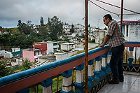 Carlos Saldana, looks out as he stands on the balcony as he attends a birthday party for their grandson, Hector Yael, 10, at a family gathering at Vicky's daughter, Cinthia Hern&aacute;ndez Delgadilo's house in Xalapa, Mexico on November 4, 2017. <br /> Photo Daniel Berehulak for The New York Times