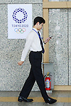A man walks past the new Tokyo 2020 Olympic Games logo on display at the Tokyo Metropolitan building on April 27, 2016, Tokyo, Japan. After scraping the original design last year due to accusations of plagiarism; The Tokyo 2020 Logo Selection Committee settled this week on a simple indigo-and-white checkered circle design by Asao Tokolo as a new emblem for the 2020 Summer Olympic Games. The final decision was announced on Monday 25th April after the selection committee had checked through almost 15,000 design proposals. The new logos are already starting to appear on Tokyo 2020 related communications. (Photo by Rodrigo Reyes Marin/AFLO)