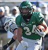 Kevin Wilson #34 of Farmingdale rushes for a first down during the Nassau County football Conference I semifinals against Oceanside at Shuart Stadium in Hempstead on Saturday, Nov. 10, 2018.