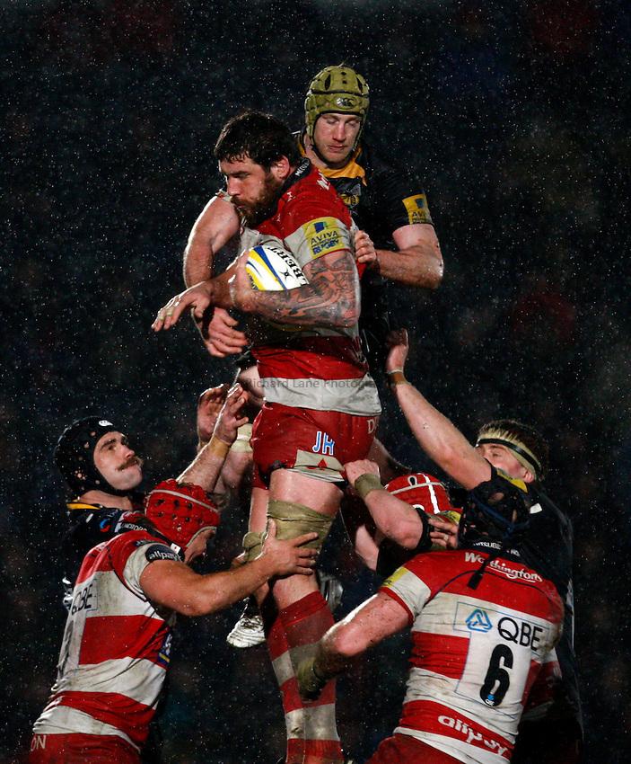 Photo: Richard Lane/Richard Lane Photography.London Wasps v Gloucester Rugby. Aviva Premiership. 13/02/2011. Gloucester's Jim Hamilton is challenged by Wasps' Richard Birkett at a lineout.