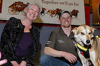 Dallas Seavey's lead dog &quot;Reef&quot; receives the City of Nome Lolly Medley Golden Harness award from Nome Mayor Denise Michaels at the finishers banquet in Nome on Sunday  March 22, 2015 during Iditarod 2015.  <br /> <br /> (C) Jeff Schultz/SchultzPhoto.com - ALL RIGHTS RESERVED<br />  DUPLICATION  PROHIBITED  WITHOUT  PERMISSION