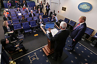 United States Vice President Mike Pence speaks as US President Donald J. Trump listens during a press conference with members of the coronavirus task force in the Brady Press Briefing Room of the White House on March 24, 2020 in Washington, DC.<br /> Credit: Oliver Contreras / Pool via CNP/AdMedia