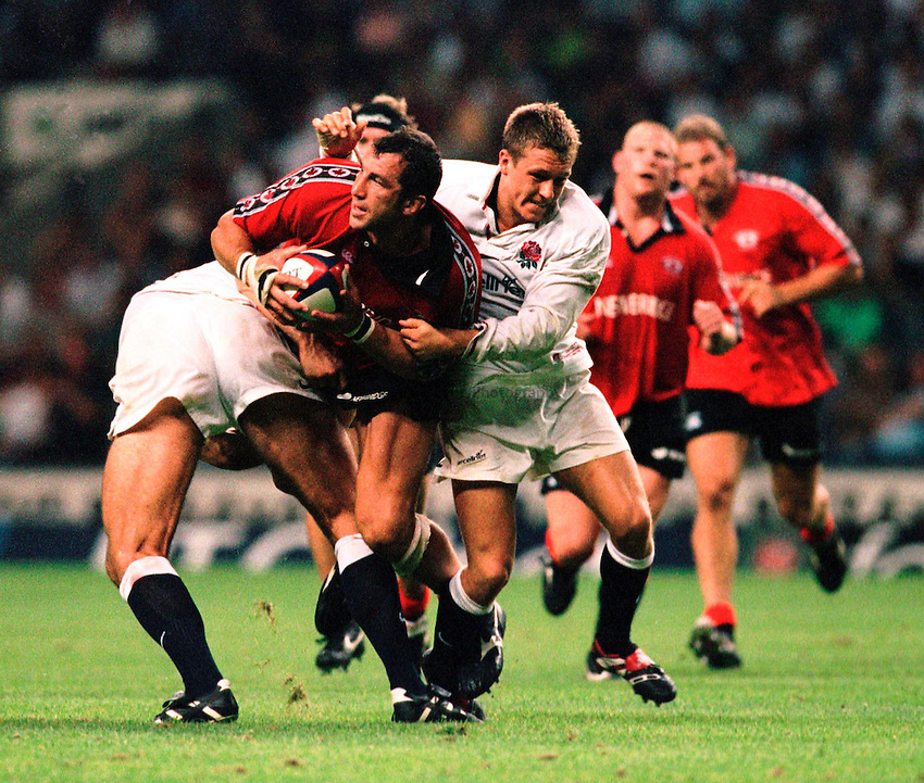 Photo. Richard Lane.England v Canada. 28/8/99..Al Charron looks for support as Jonny Wilkinson and Lawrence Dallaglio tackle.