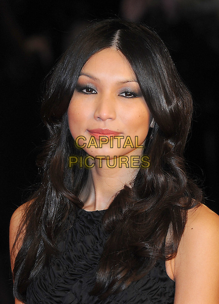 GEMMA CHAN.European Premiere of 'Brighton Rock' at the Odeon West End, Leicester Square, London, England, UK,.1st February 2011..headshot portrait sleeveless dress eyeliner make-up beauty .CAP/BEL.©Tom Belcher/Capital Pictures.