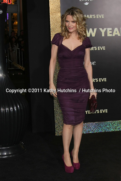 """LOS ANGELES - DEC 5:  Michelle Pfeiffer arrives at the """"New Year's Eve"""" World Premiere at Graumans Chinese Theater on December 5, 2011 in Los Angeles, CA"""