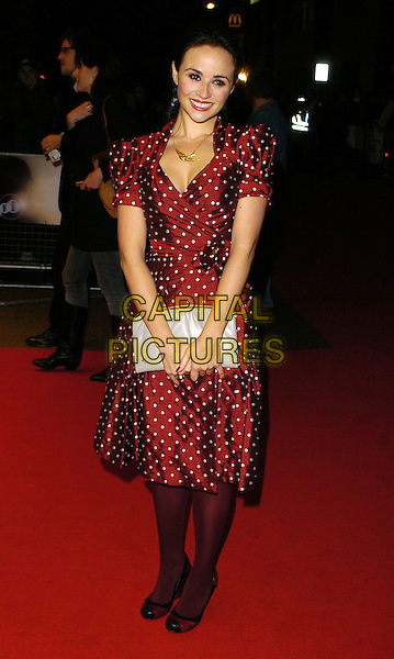 "EMMA PIERSON.Attends ""The Lives Of The Saints"" UK Film Premiere, held at the Odeon West End Cinema, London, England, October 20th 2006..full length red and white polka dot silk satin dress tights black shoes grey clutch bag gold necklace.Ref: CAN.www.capitalpictures.com.sales@capitalpictures.com.©Can Nguyen/Capital Pictures"