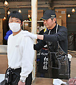 April 14, 2011, Ishonomaki, Japan - Japanese actor Tetsuya Watari, right, of Ishihara Promotion gives his autograph to a quake victim as he and fellow actor Testsuya Watari run a soup kitchen in Ishonomaki, Miyagi Prefecture, on Thursday, April 14, 2011. The two big stars led Ishihara Promotion in providing meals for one week for the victims of March 11 earthquake and tsunami in this northeastern Japanese town. (Photo by AFLO) [3620] -mis-