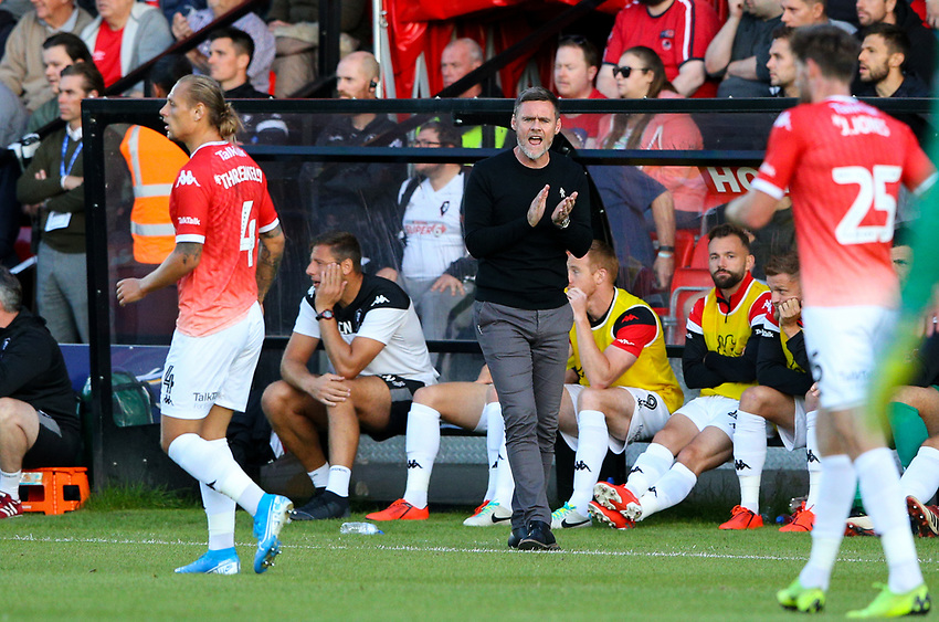 Salford City manager Graham Alexander shouts instructions to his team from the technical area<br /> <br /> Photographer Alex Dodd/CameraSport<br /> <br /> The Carabao Cup First Round - Salford City v Leeds United - Tuesday 13th August 2019 - Moor Lane - Salford<br />  <br /> World Copyright © 2019 CameraSport. All rights reserved. 43 Linden Ave. Countesthorpe. Leicester. England. LE8 5PG - Tel: +44 (0) 116 277 4147 - admin@camerasport.com - www.camerasport.com