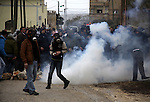 Palestinian protesters run away from tear gas canisters fired by Israeli soldiers during a demonstration against the expropriation of Palestinian land by Israel in the village of Kfar Qaddum, near the West Bank city of Nablus, on March 2, 2012.  Photo by Wagdi Eshtayah