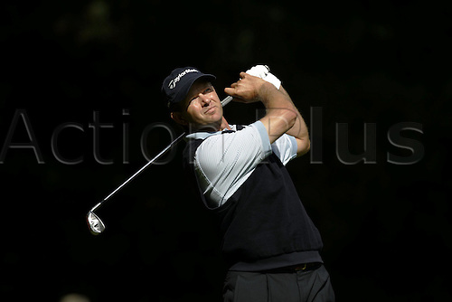 16 September  2005:  South African golfer Retief Goosen (RSA) looks into the distance after playing from the 2nd tee during his second round match against Hensby on day 2 of The HSBC World Matchplay Championship, West Course, Wentworth. Goosen won the match 12 and 11. Photo: Glyn Kirk/Actionplus...050916 man men golf player