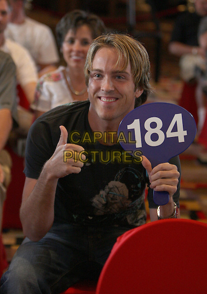 LARRY BIRKHEAD .Pamela Anderson Auctions her car off for PETA at Planet Hollywood Resort Hotel and Casino, Las Vegas, Nevada, USA..June 21st, 2008.half length sitting 184 sign thumb up hand sitting black t-shirt .CAP/ADM/MJT.© MJT/AdMedia/Capital Pictures.